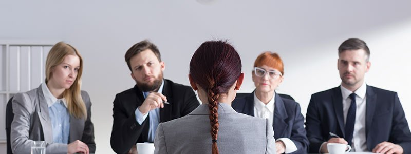 Job interview panel questioning a girl